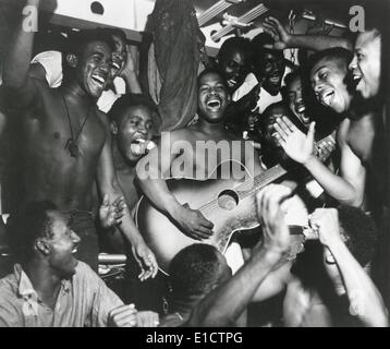 African American sailors aboard the U.S.S. Ticonderoga celebrate the news of Japan's surrender. Aug. 14, 1945 at - Stock Photo