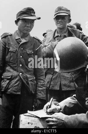 Japanese youth, wearing a Nazi uniform, was among German prisoners captured on the beaches of France. American Army - Stock Photo
