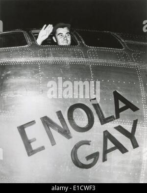 Col. Paul W. Tibbets, Jr., pilot of the ENOLA GAY waves from his cockpit before the takeoff. Several hours later, - Stock Photo