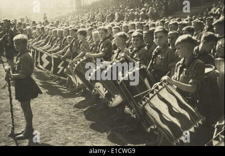 Hitler Youth drum corps at a rally. Their drums bear skull and runic 'S' symbols of the Elite Nazi SS troops. Ca. - Stock Photo