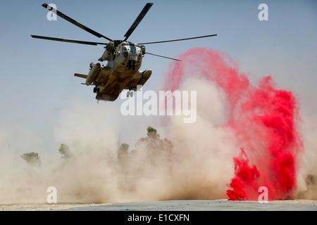 A U.S. Marine Corps CH-53D Sea Stallion helicopter lands to deliver supplies at Patrol Base Jaker, Afghanistan, July 28, 2009. Stock Photo