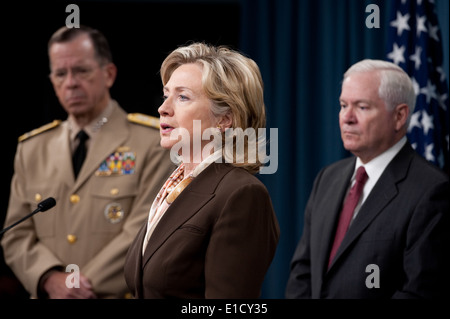 Secretary of State Hillary Rodham Clinton, center, speaks during a press conference on the new Nuclear Posture Review - Stock Photo