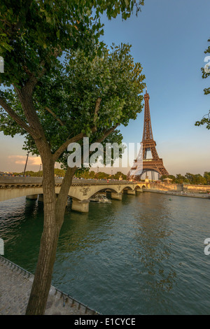 Eiffel Tower and Seine River at sunset from Port Debilly in Trocadero - Stock Photo