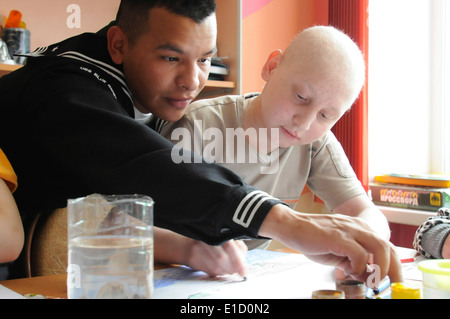 100507-N-9094S-375 VLADIVOSTOK, Russia (May 7, 2010)--Logistics Specialist Seaman Sergio Torres, a Sailor aboard - Stock Photo