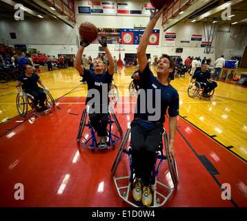 U.S. Sailors warm up before a preliminary wheelchair basketball game against an Air Force team at the inaugural - Stock Photo
