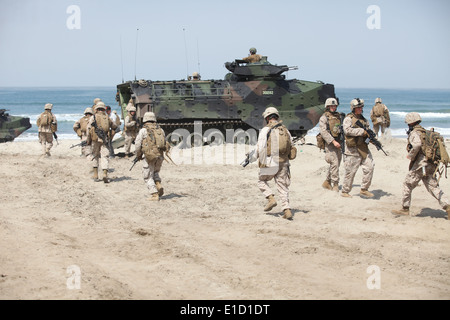 U.S. Marines with 1st Battalion, 7th Marine Regiment return to their amphibious assault vehicles on Camp Pendleton, - Stock Photo