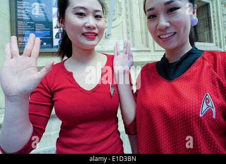 London, UK. 31st May, 2014. Star Trek fans give a vulcan salute outside the Albert Hall as they wait for the Star - Stock Photo