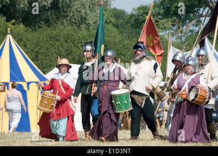 Tewkesbury Medieval Festival, Gloucester UK July 2013: female drummers lead the soldiers in the march to war - Stock Photo