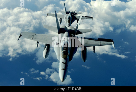 U.S. Marine Corps F/A-18 Hornet aircraft from Marine Fighter Attack Squadron (VMFA) 224 fly over Joint Base Pearl - Stock Photo