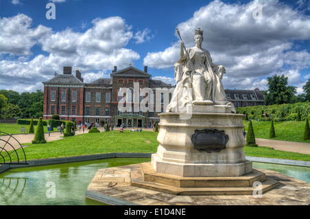 HDR image of A Statue of Queen Victoria outside of Kensington Palace a royal residence set in Kensington Gardens, - Stock Photo