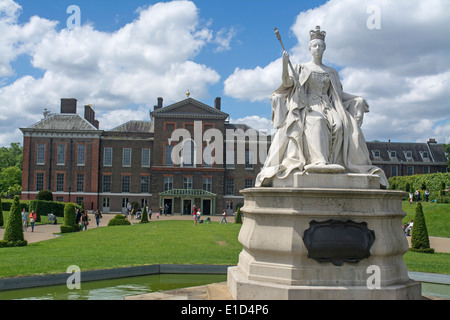 Statue of Queen Victoria outside of Kensington Palace a royal residence set in Kensington Gardens London England - Stock Photo