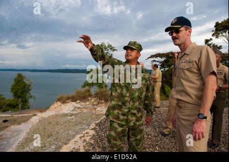A Colombian marine, left, shows U.S. Navy Capt. Peter Brennan the barracks at Bahia Malaga Naval Base, Colombia, - Stock Photo
