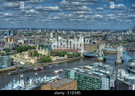HDR image of Tower Bridge, Tower of London, HMS Belfast and the River Thames from the 35th floor of The Shard. - Stock Photo