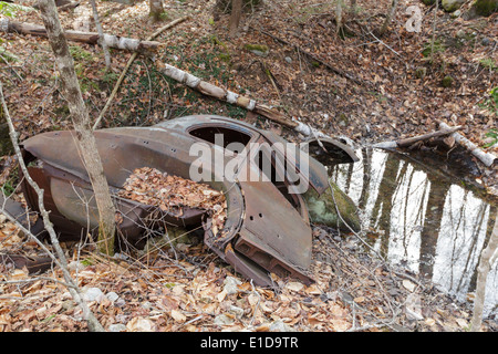 Abandoned car at the site of the old North Woodstock Civilian Conservation Corps Camp in North Woodstock, New Hampshire - Stock Photo