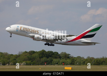 Emirates Airbus A380 double deck, wide body, four-engine jet airliner manufactured by Airbus taking off - Stock Photo