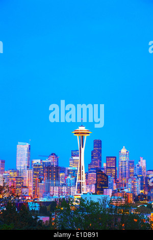 Downtown Seattle cityscape with Space Needle at night time as seen from the Kerry park - Stock Photo