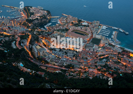 MONACO-VILLE & FONTVIEILLE DISTRICT in Monaco. Seen at night from an elevation of 500 meters AMSL. - Stock Photo