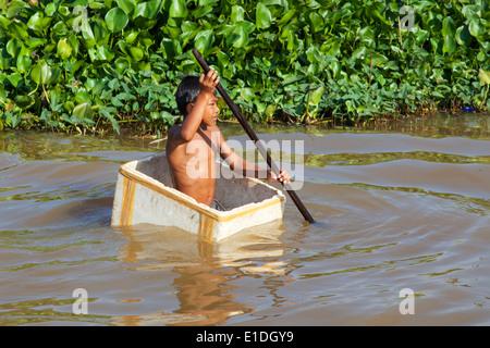 A Kid Playing in Kampong Phulk Floating Village, Siem Reap, Cambodia - Stock Photo