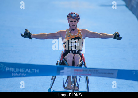 Hyde Park, London UK. 31st May 2014. Geert Schipper (NED) approaches the line in the PruHealth World Paratriathlon - Stock Photo