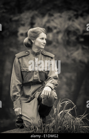 Young woman in Red Army form of 1943 year. Image with film grain effect. - Stock Photo