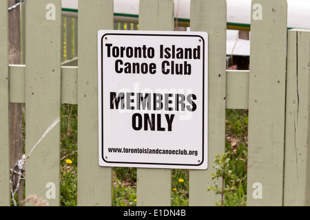 Member's only sign on fence at the Toronto Island Canoe Club - Stock Photo