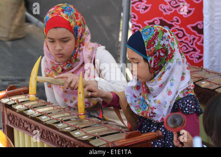 London, UK. 31 May 2014. Two Indonesian girls attend the Gamelan Music Workshop conducted by Aris Daryono. Credit: - Stock Photo