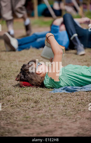 Hay on Wye, UK. 1st June, 2014. Pictured: A woman lays in the sun at Hay Re: Hay Festival, Hay on Wye, Powys, Wales - Stock Photo