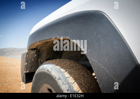 Closeup image of a offroad car in the desert of Oman - Stock Photo