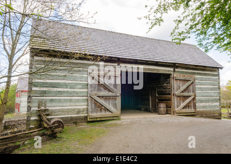 Old fashioned wooden barn from Pennsylvania in the Ulster American Folk Park, Northern Ireland - Stock Photo