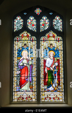 Stained glass windows depicting the virtues 'Faith' and 'Hope' - Stock Photo