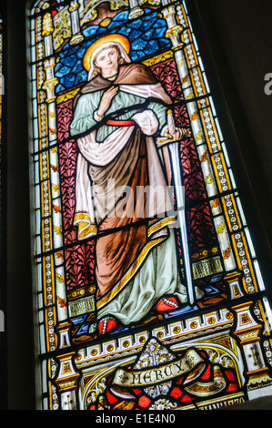 Stained glass windows depicting the virtue 'Mercy' - Stock Photo