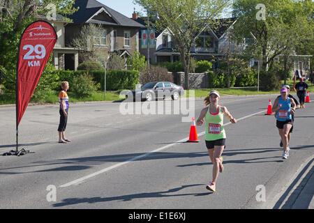 Calgary, Alberta, Canada. 01st June, 2014. Runners pass 29 km marker in the 50th Scotiabank Calgary Marathon on - Stock Photo
