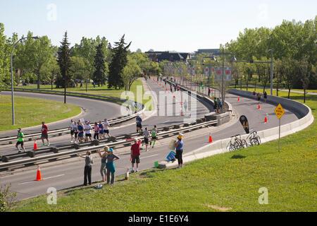 Calgary, Alberta, Canada. 01st June, 2014. Runners racing along Memorial Drive in the 50th Scotiabank Calgary Marathon - Stock Photo