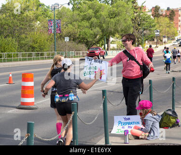 Calgary, Alberta, Canada. 01st June, 2014. Spectators encourage runners in the 50th Scotiabank Calgary Marathon - Stock Photo