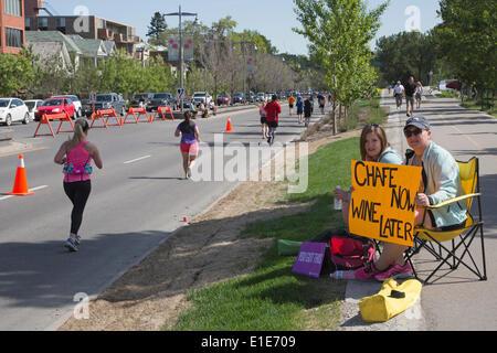 Calgary, Alberta, Canada. 01st June, 2014. Spectators watch runners race along Memorial Drive in the 50th Scotiabank - Stock Photo
