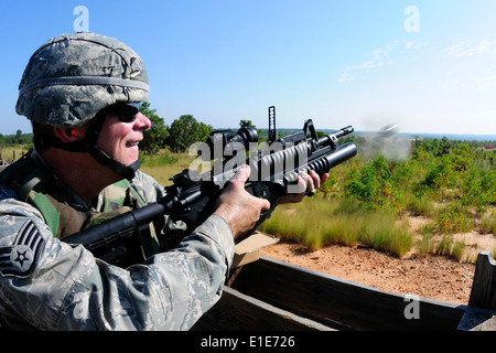 U.S. Air Force Staff Sgt. Patrick Murphy fires an M-203 grenade launcher during annual heavy weapons training at - Stock Photo