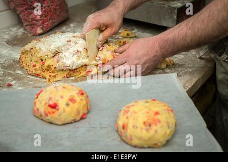 The brioche with sugared almonds making (cake of Saint Génix). Fabrication de brioches aux pralines (Gâteau de Saint - Stock Photo