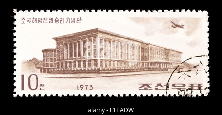 Postage stamp from North Korea depicting the War Museum in Pyongyang. - Stock Photo