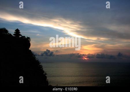 sunset at uluwatu temple bali - Stock Photo