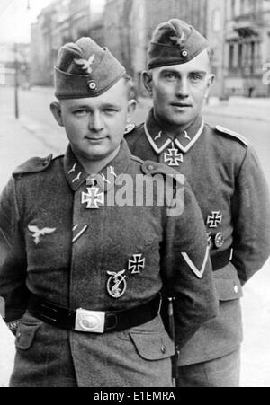 The picture from Nazi news reporting shows two anti-aircraft soldiers of the German Wehrmacht (armed forces) wearing - Stock Photo