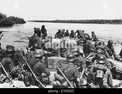 Propaganda text! from Nazi news reporting on the back of the picture: 'With assault boats across the Don River.' - Stock Photo