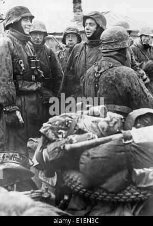 Propaganda text! from Nazi news reporting on the back of the picture: 'The convoy stops! A motorcycle dispatch rider - Stock Photo