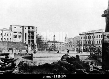 Propaganda text! from Nazi news reporting on the back of the picture: 'Kharkov. Barricades were erected most of - Stock Photo