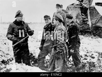 German soldiers prepare to attack American troops along the Huertgen Forest front near Aachen, Germany, December - Stock Photo