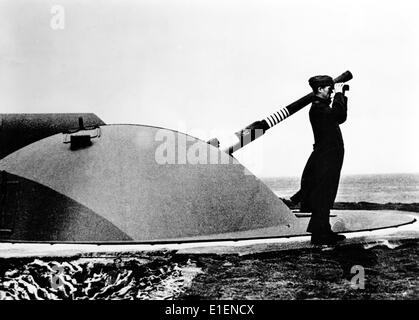 The picture from a Nazi news report shows a soldier from the German army looking through binoculars at a fortification - Stock Photo