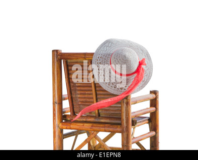 hat on a bamboo chair isolated on white background - Stock Photo
