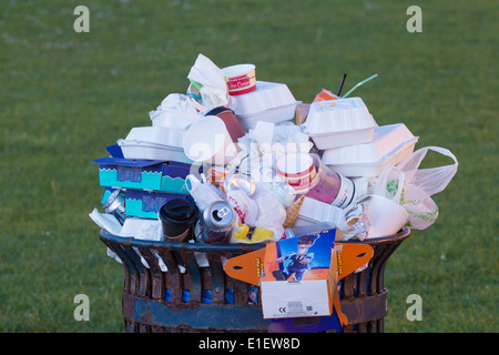 Coastal litter bin overflowing with plastic and styrofoam packaging from seafront fish & Chip/takeaway shops. UK - Stock Photo