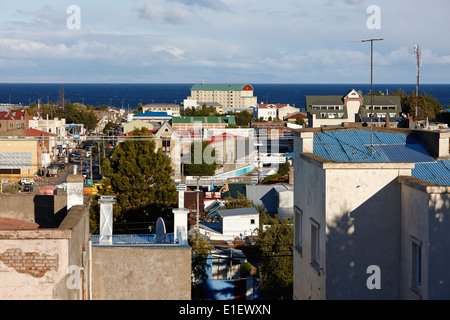 view over rooftops towards sea in Punta Arenas Chile - Stock Photo