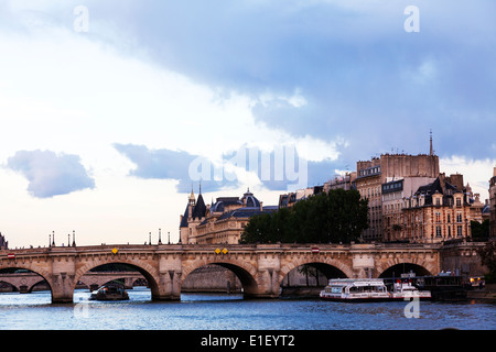 The Palais de Justice, Ile de la Cite, Paris, France Pont Neuf over river Seine - Stock Photo