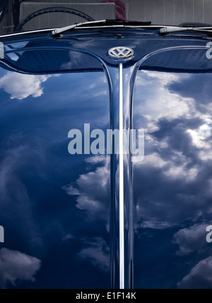 VW Beetle car. Front end with cloud reflections - Stock Photo